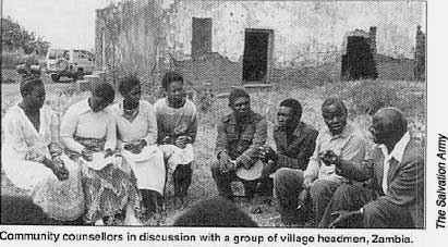 Community counsellors in discussion with a group of village headmen, Zambia